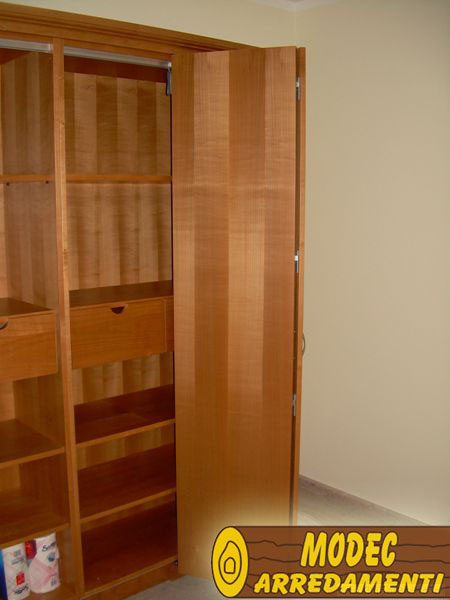 Ambienti personalizzati camere armadi e librerie modec for Ambienti arredamenti