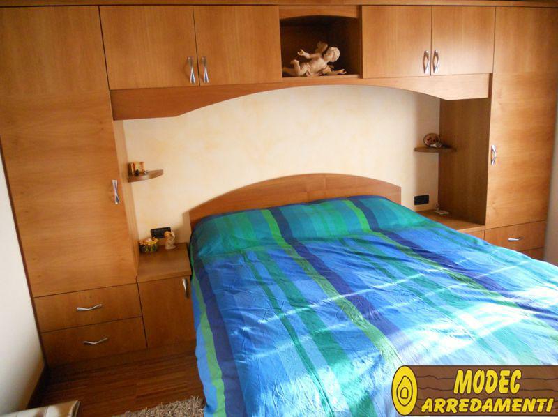 Ambienti personalizzati camere armadi e librerie modec for Della camera arredamenti levane